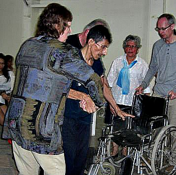 Jesus Heals The Sick. This man,paralyzed for years, got out of his wheelchair and walked!