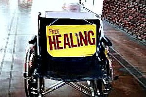 Free Healing, with photo of an empty wheelchair